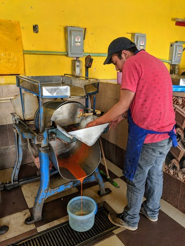 Grinding our mole at the local molina. For a small fee, they will grind your coffee, cacao, grains, or in our case, mole.