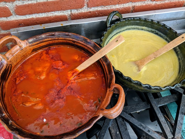 Mole amarillo and potato cream soup simmering. Amorillo means yellow, but then why is it red? Apparently it was originally made with a yellow pepper, but now most people make it with other peppers, which are red.