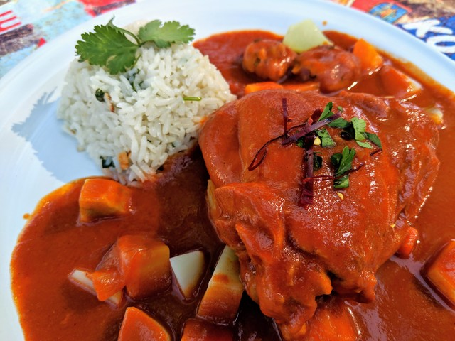The finished mole amarillo with chicken, rice and potatoes.