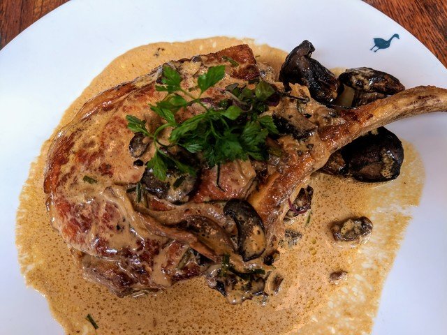 Best pork chop ever! Mushrooms and white wine sauce.
