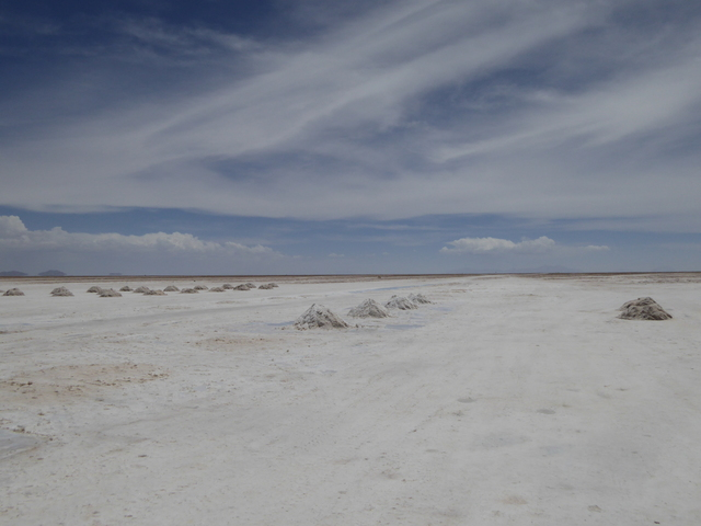 "Salar de Uyuni, which translates roughly to ""enclosed salt flat"". Uyuni is an Amara (one of the indigenous people of the Andes) word, Salar is Spanish. These are the largest salt flats in the world, with a total area of over 10,000 km or 4,000 mi."