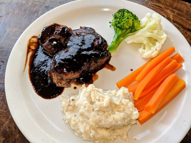 Steak with tamarind sauce and garlic mashed potatoes.