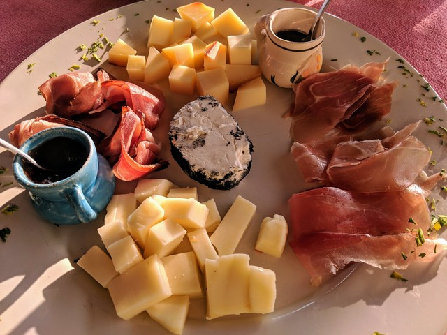 Cheese plate with manchego, blue cheese and I think mozzarela, plus two kinds of cured meat. Pretty fancy for a little beach town!