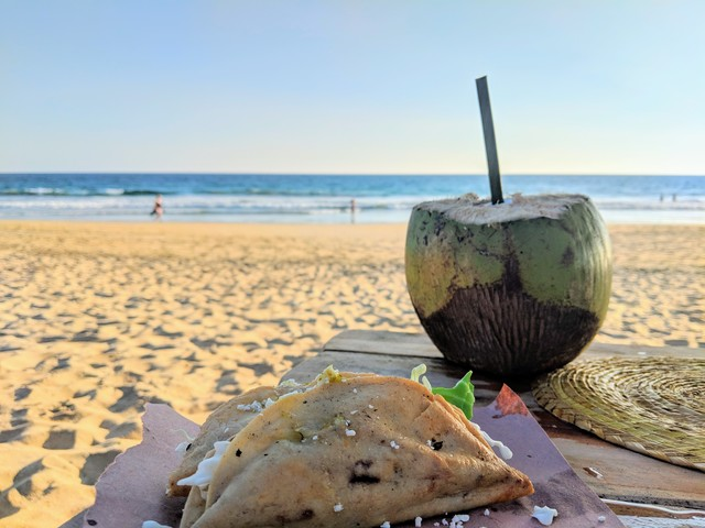 Fish tacos and fresh coconut water on the beach