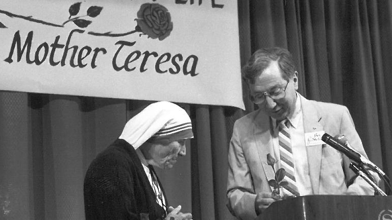 Ben presents Mother Teresa with a budding rose, a symbol of life in the womb.