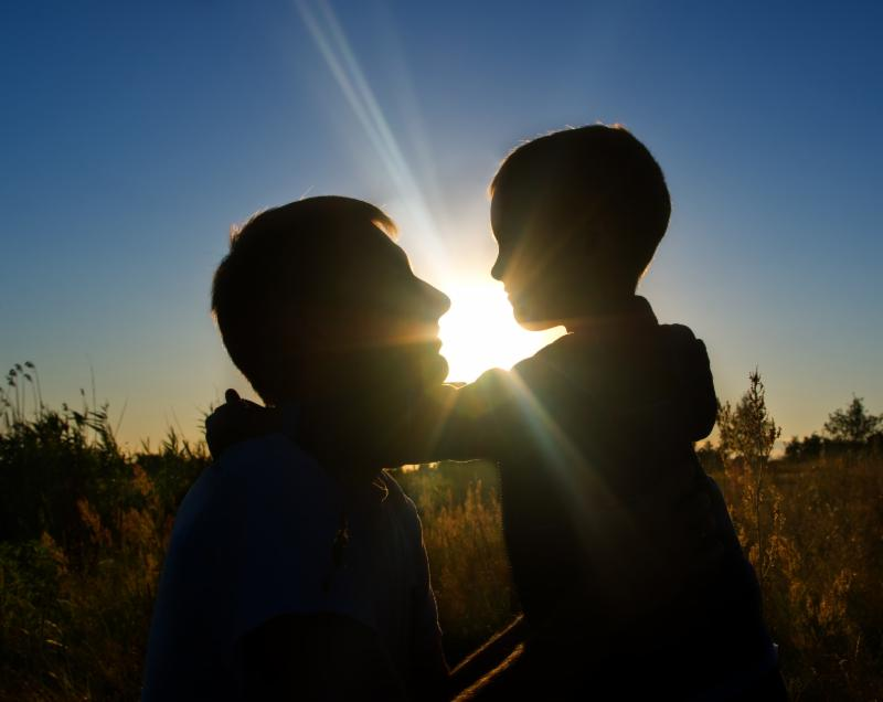Dad and son silhouette
