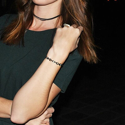 Rocksbox Member wearing a House of Harlow 1960 Sierra Pyramid Cuff in Silver.