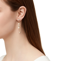 Model Content for House of Harlow 1960 Triangle Trellis Drop Earrings in White