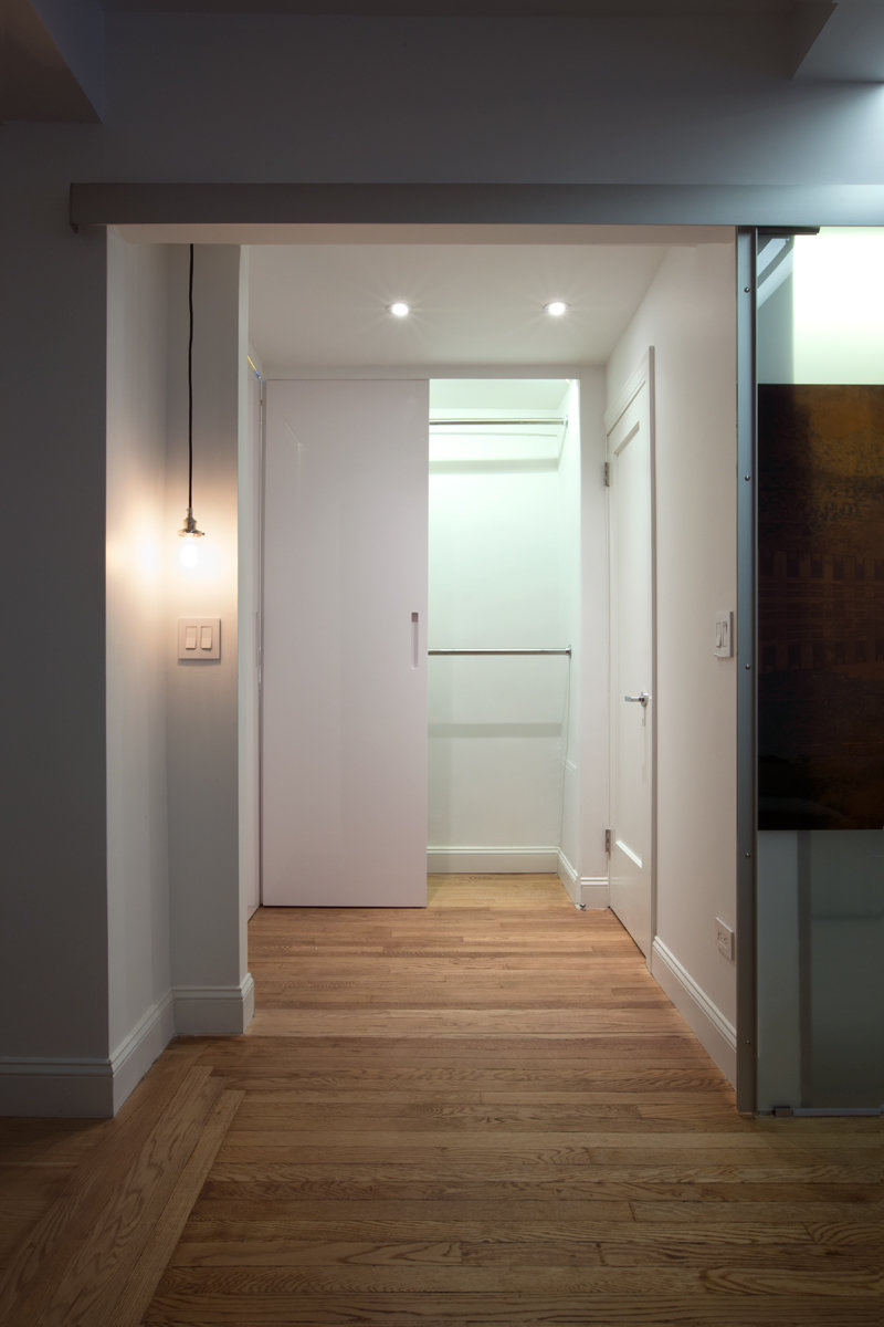 These doors in glossy white lacquer not only are a