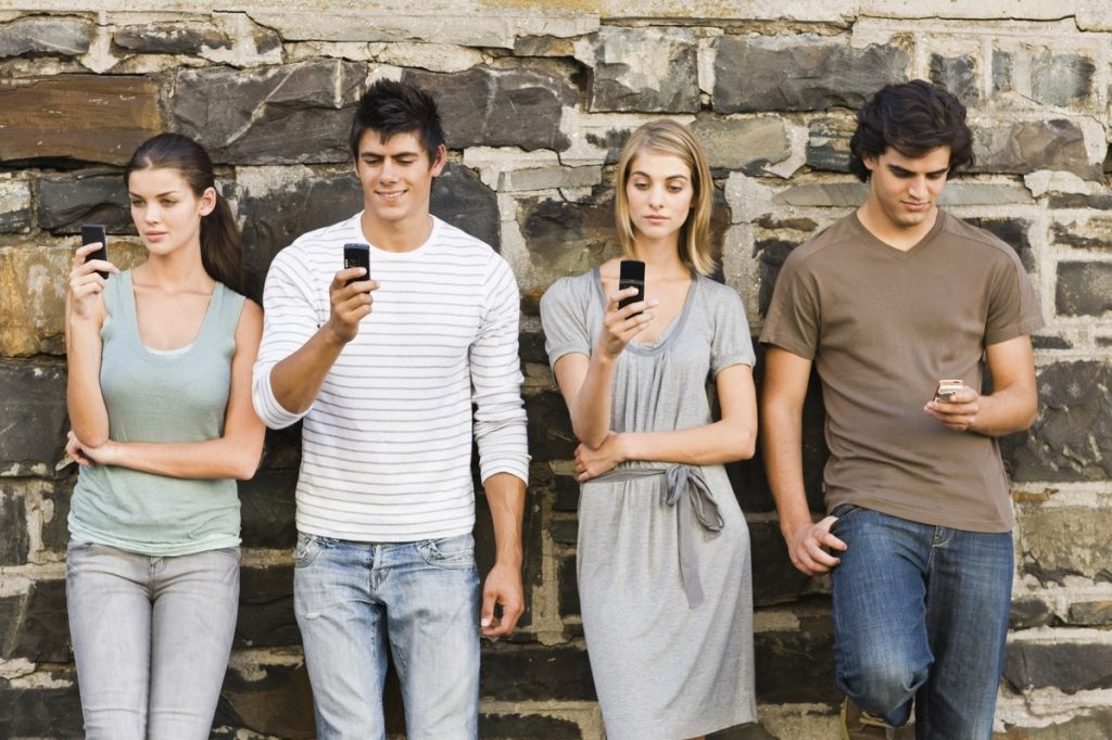 Why Teens Compulsively Use Social Media: To Feel Connected but Without Risk and Vulnerability