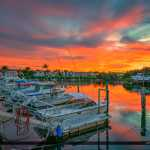 Boats at North Palm Beach Marina Sunset with Red Colors