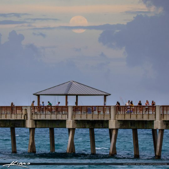 First Glimpse of the Full Moon Rising Over Juno Beach Pier Tonig