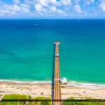 Aqua Blue Water at Juno Beach Pier Sunny Day Aerial Photography