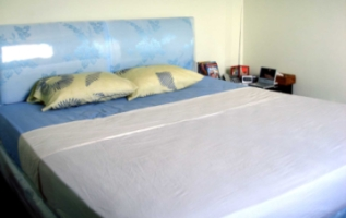 A neatly made bed demonstrating a high standard