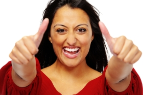 Indian woman happily placing her thumbs in the air