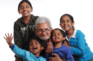 Indian grand kids in their grandfather's arms