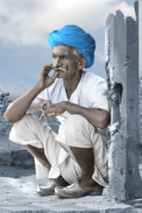 Indian man smoking a cigarette and wearing a blue turban