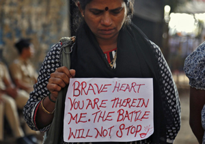 A woman mourns the death of the young woman that was brutally raped in New Delhi, Source: Reuters