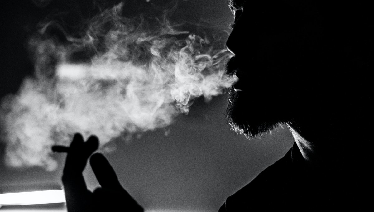 Image of a man smoking bidi