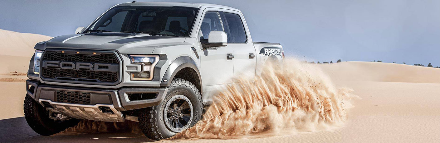 ford raptor f-150 drifting on sand_o