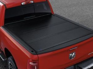 "2019 RAM 1500 (DT 5th Gen) Black Hard Folding Tonneau Cover - Conventional Bed 5'7"" - Mopar (82215227AC)"