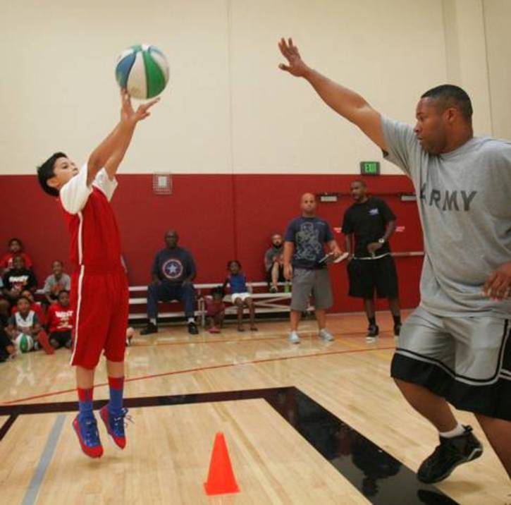 Aaron delatorre attempting a shot over coach andre frazier