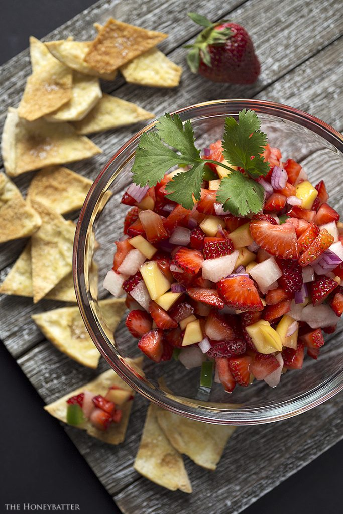 If you've never tried salsa with strawberries, you won't believe how the spicy jalapeno and sweet strawberries and mango make this recipe like summer in a bowl.