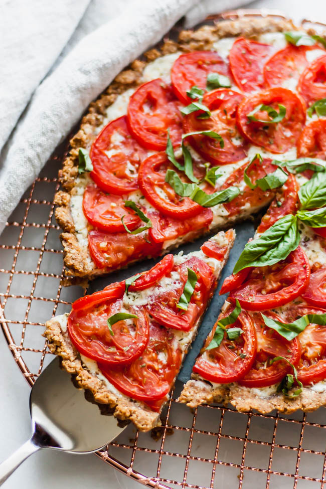 ThisGluten Free Tomato Tart with Creamy Mozzarella Filling tastes like an inside-out pizza with fresh tomatoes. It's perfect for using up ripe, summer tomatoes.