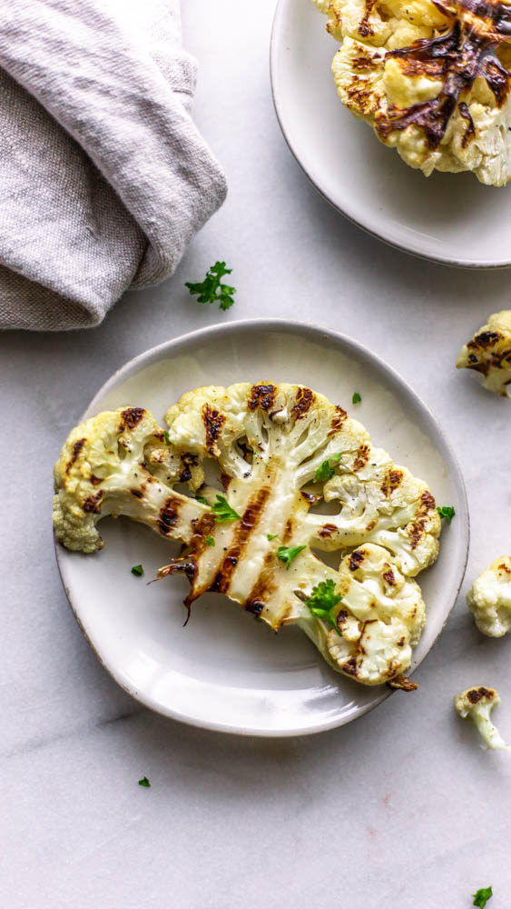 Grilled Cauliflower Steaks are a hearty side dish or light main dish to serve during the summer months. The char creates a wonderful flavor and texture.