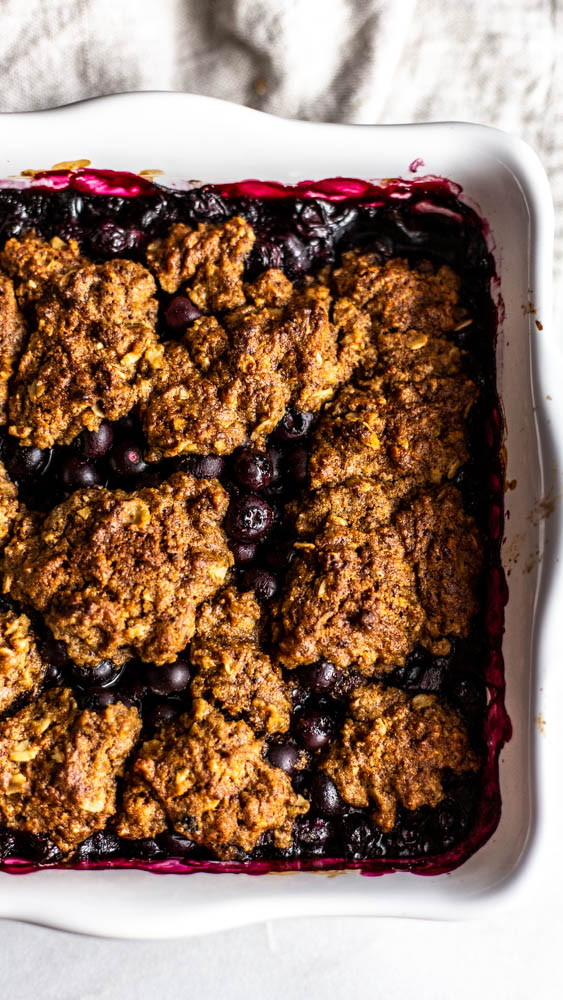 Nothing says summer like perfect blueberries made into a healthier cobbler.