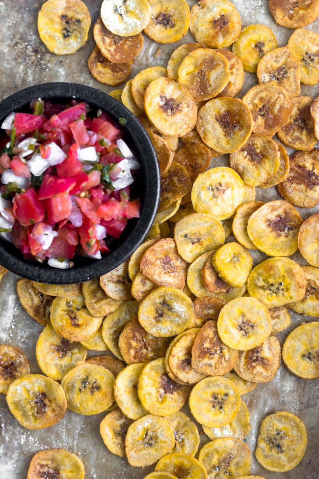 We are using plantains, which are referred to as cooking bananas, as our chip. All you need is green plantains, oil, and salt to make the most perfect crispy chip.