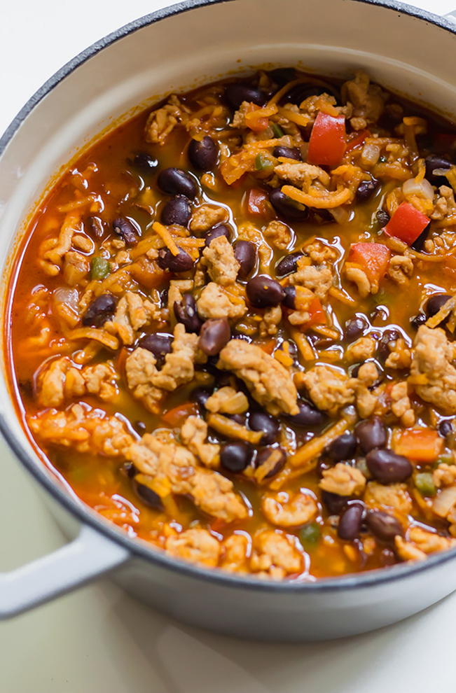sweet potato, ground chicken, black beans and red tomatoes in a both with red chili broth