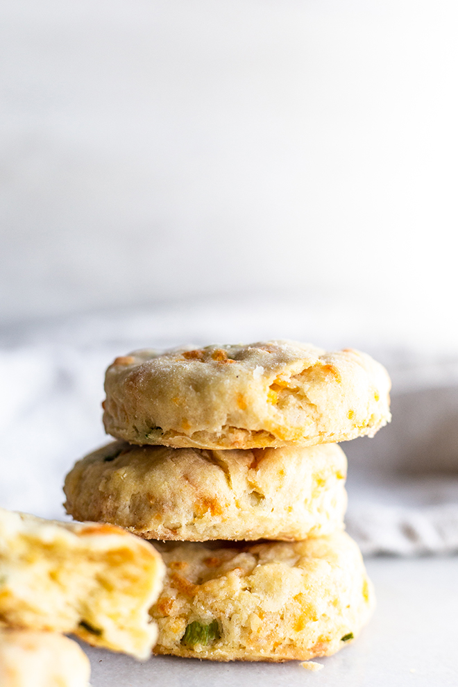 These Cheddar and Green Onion Biscuits are perfect to serve alongside a steaming bowl of soup to take comfort food to the next level.