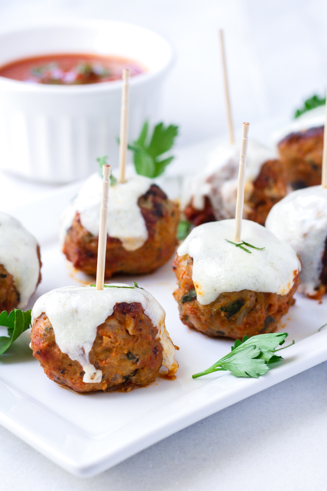 It's Fall Cocktail Party Week here at Pure Taste, and we are making some delicious Turkey Meatball Mozzarella Skewer appetizers. These turkey meatballs are filled with melted mozzarella and topped with even more mozzarella! We are drooling over here!