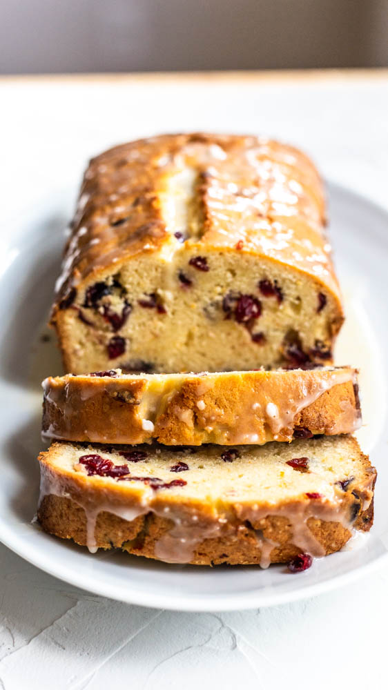 ThisCranberry Orange Bread with Cranberry Glaze can be eaten for breakfast and lunch. Don't even get us started about that luscious orange glaze.