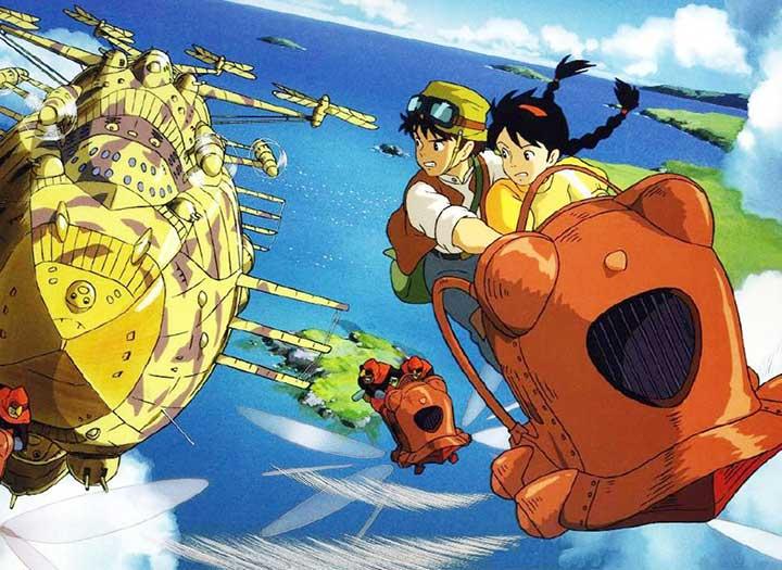 Dos chicos en una aeronave perseguidos por otros vehículos en el aire en la película el castillo volador de Hayao Miyazaki