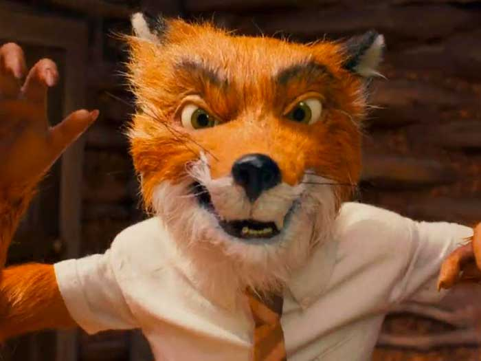 Un zorro con corbata mira hacia cámara con malicia en Fantástico Sr. Fox