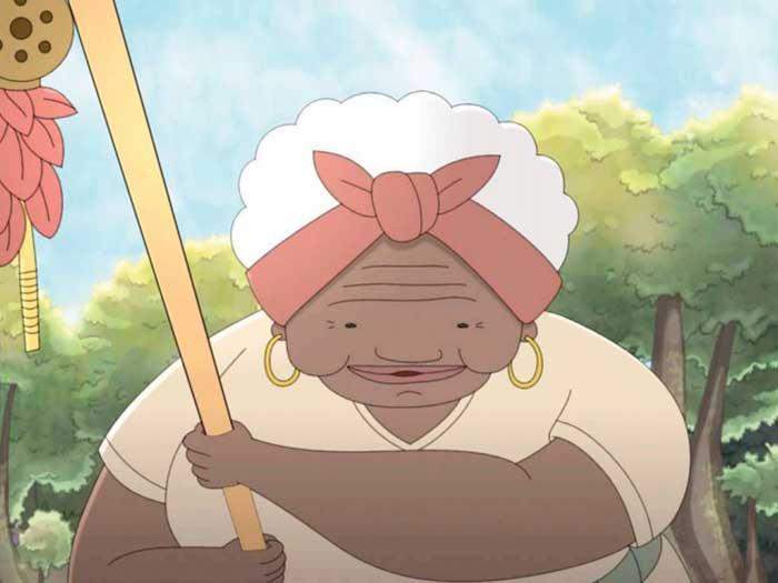 Una anciana afro sostiene un bastón mágico en la película El libro de Lila