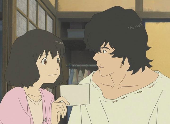 Un hombre y una mujer en el interior de una casa japonesa en Los niños lobo