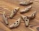 African Brass Boomerang w/ Circles 34-40x13-15mm