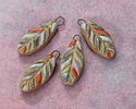 Gaea Ceramic Hand Painted Pastels on Cream Small Feather Focal 10x23-24mm