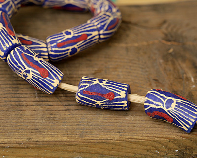 African Handpainted Print in Cream/Red on Blue Powder Glass (Krobo) Bead 23-25x12mm