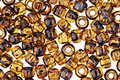 TOHO Transparent Light Topaz Picasso Hybrid Round 6/0 Seed Bead