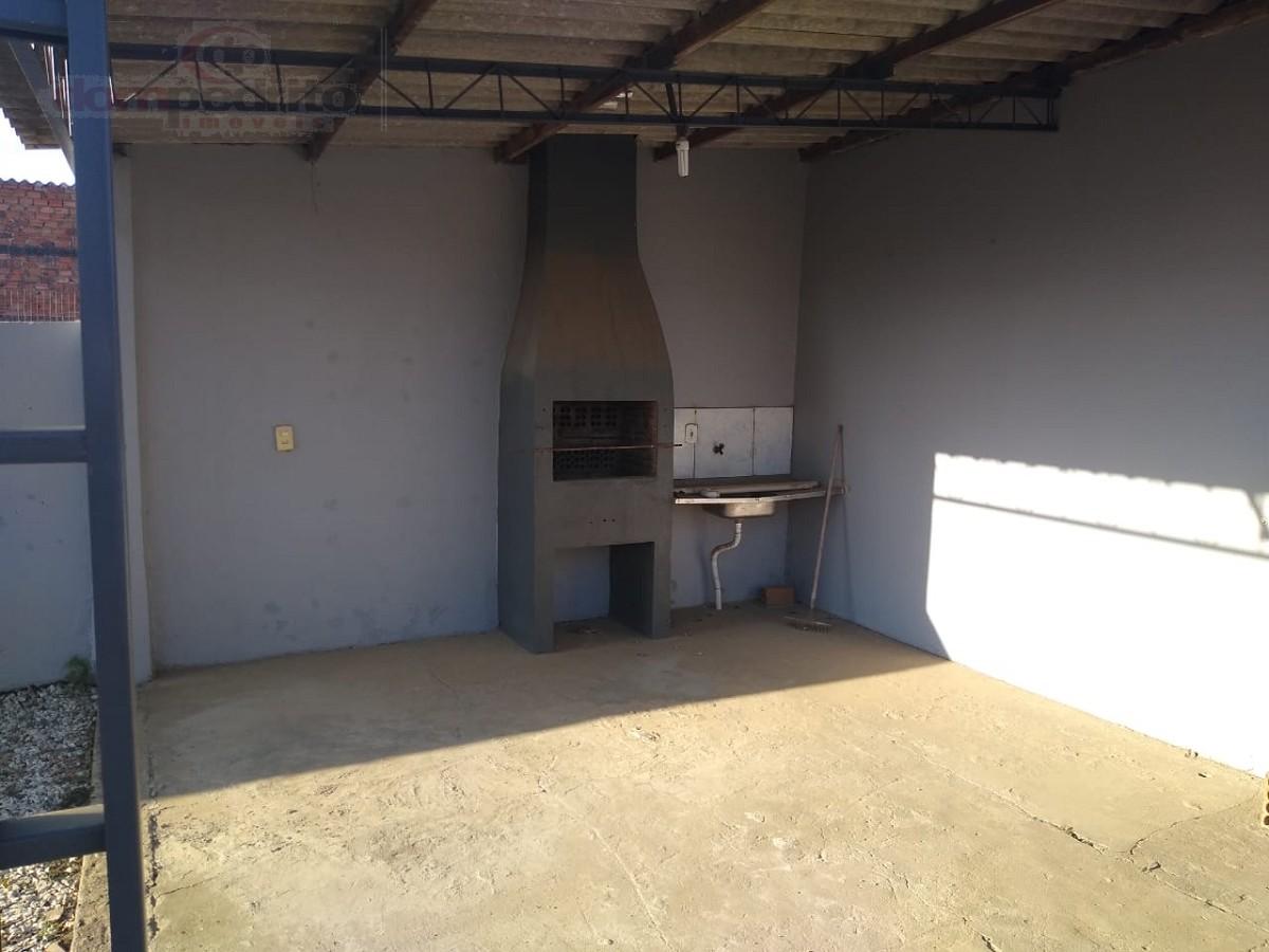 Garagem com churrasqueira