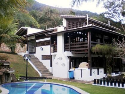 Ver mais detalhes de Casa com 4 Dormitórios  em Guaecá - São Sebastião/SP