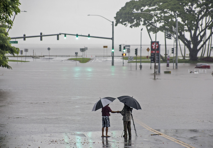Floodwaters from Hurricane Lane made the intersection of Kamehameha Avenue and Pauahi Street impassable on Thursday, Aug. 23, 2018, in Hilo, Hawaii
