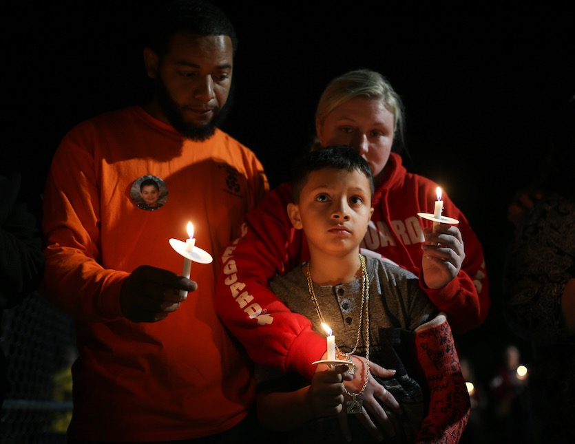 The parents and brother of Armando Hernandez, 6, the youngest victim of the deadly EF4 tornado that passed through Lee County, Alabama, on March 3, 2019, participate in a candlelight vigil for the 23 victims on March 11, 2019 in Beauregard, AL.
