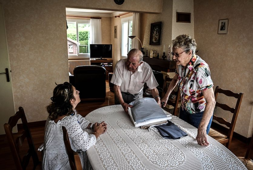 Vanessa Deschamps (left), an employee of the French city of Oyonnax, meets with residents on July 11, 2019