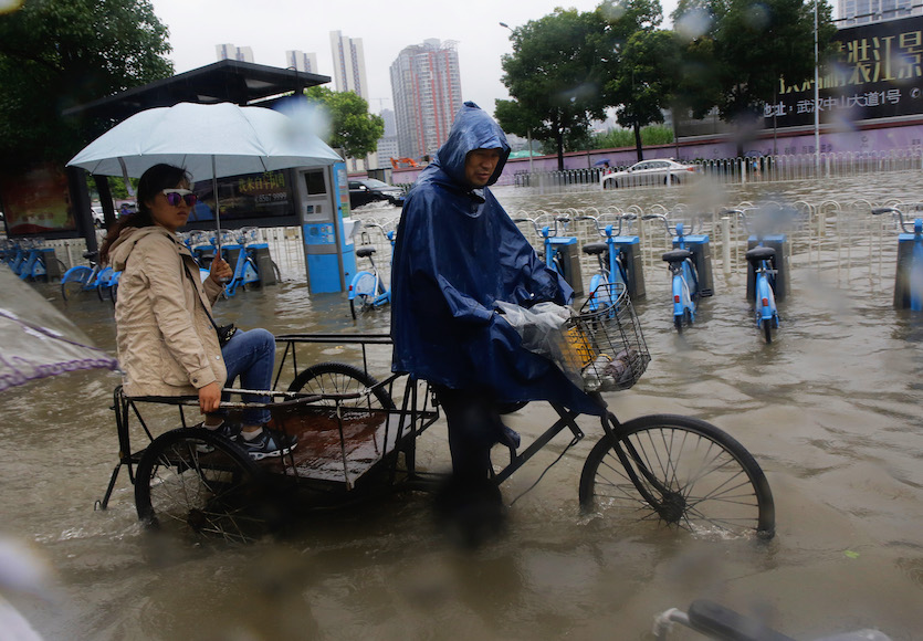 Flooded roads impede traffic in Wuhan, China, on July 6, 2016