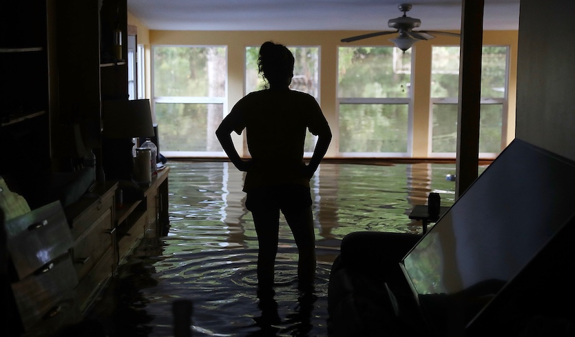 Leslie Andermann Gallagher surveys the flood damage to her home on August 17, 2016 in Sorrento, Louisiana